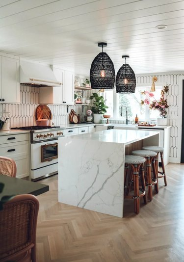 black and white farmhouse kitchen with black woven pendant lights