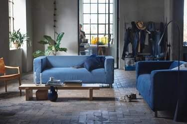 living room with couches that feature covers made of recycled denim