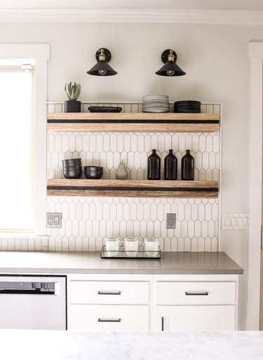 black and wood floating shelves with black wall sconces