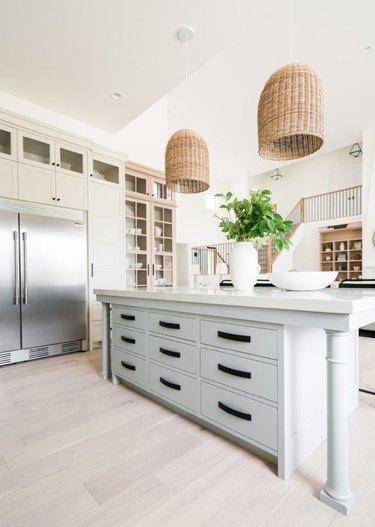 white farmhouse kitchen with basket style pendant lights