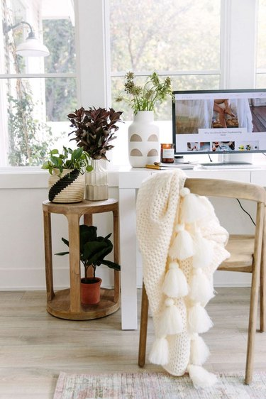 neutral home office with wood office chair and side table
