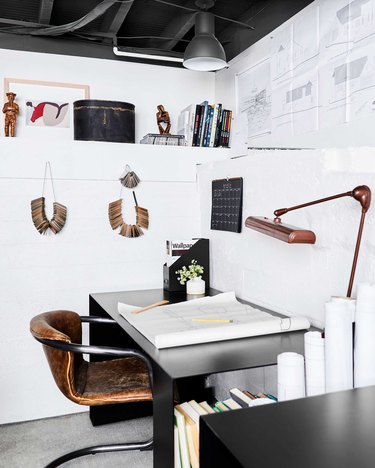 neutral home office with white walls and a leather office chair