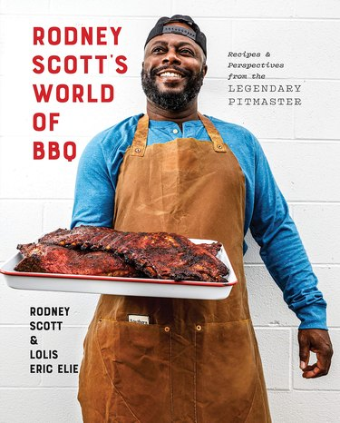 "cookbook cover featuring Rodney Scott holding BBQ with text that reads ""Rodney Scott's World of BBQ"""