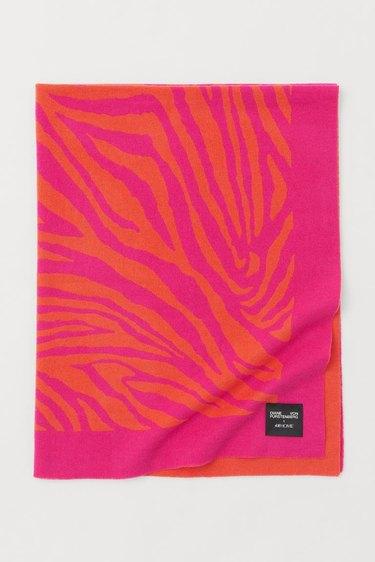 pink and orange zebra print throw