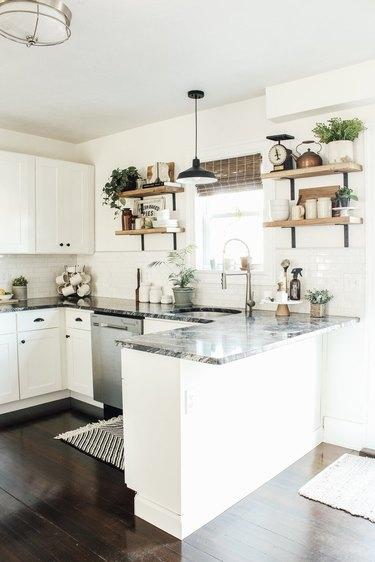 white u-shaped kitchen with gray granite countertop
