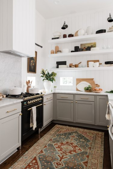 white and gray vintage u-shaped kitchen with shiplap