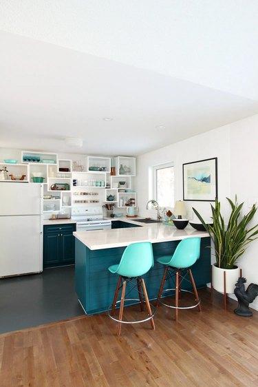 blue midcentury u-shaped kitchen with geometric shelving