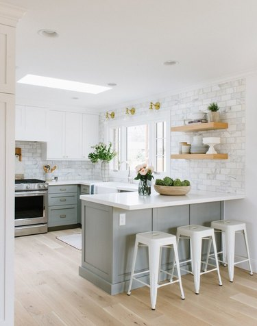 The stainless steel oven is a modern touch in an otherwise traditional kitchen.