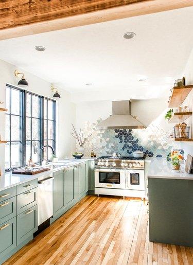 modern green u-shaped kitchen with geometric backsplash