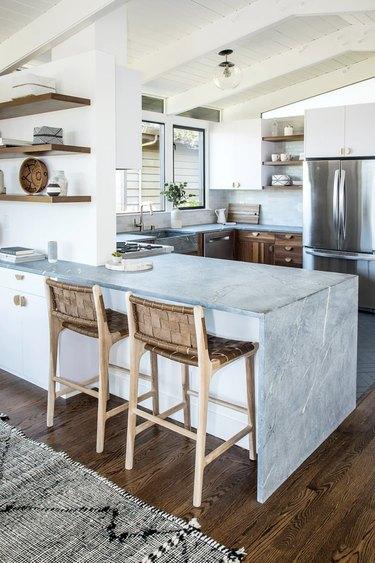 modern u-shaped kitchen with waterfall peninsula