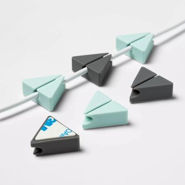cable clips on wire next to other cable clips
