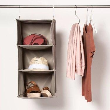 hanging closet organizer next to hanging clothing