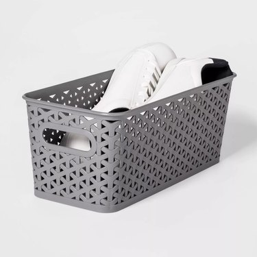 basket with shoes inside