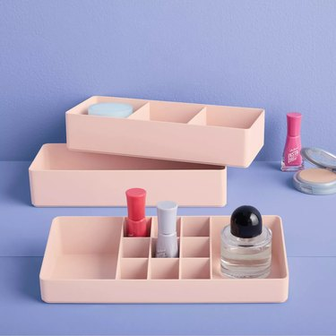 makeup organizer with makeup bottles inside and nearby