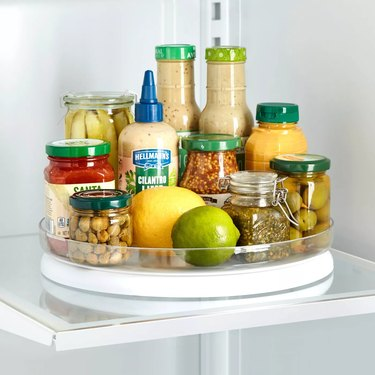 turntable organizer in fridge with condiments
