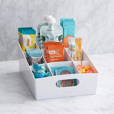 white shelf bin with snacks