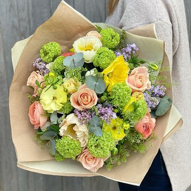 spring bouquet in brown wrapping paper