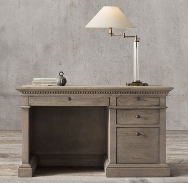 antiqued gray oak desk with traditional details and drawers for storage