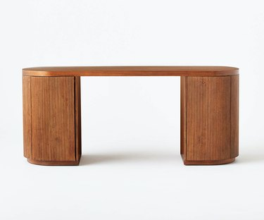 fluted oval desk with hidden storage