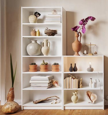 ikea white billy bookcase with books and vases