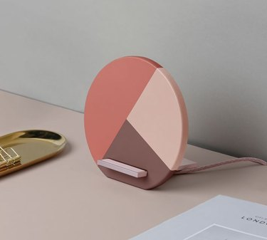pink and brown colorblocked cell phone charging station