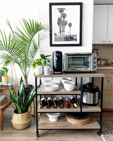 rustic wood and black kitchen cart with appliances on shelves