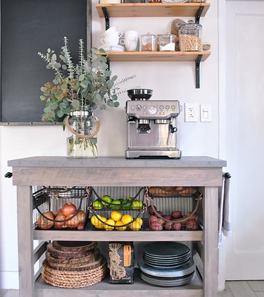 wood farmhouse kitchen cart with wire baskets filled with produce