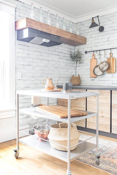 stainless steel kitchen cart in farmhouse kitchenette