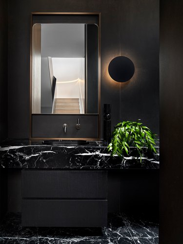 all black bathroom with marble sink