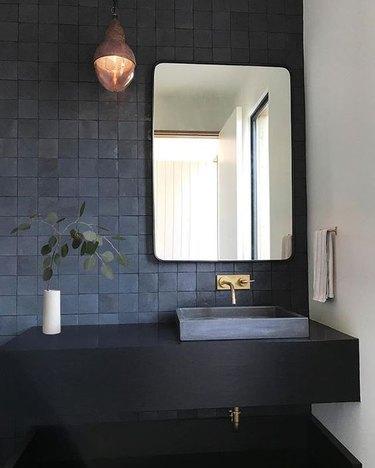 all black bathroom with tile backsplash and floating vanity