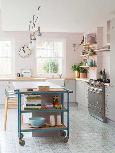 vintage blue kitchen cart in modern pink and white kitchen