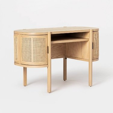 caned desk with built-in storage
