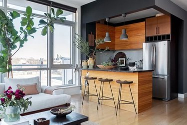 black kitchen with wooden built-ins