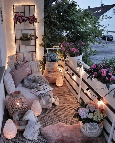 netral balcony with flowers and string lights