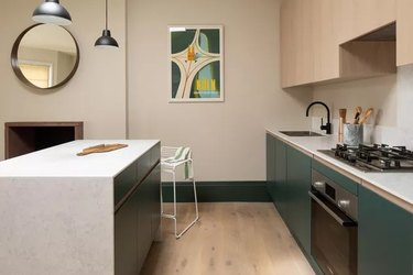 modern kitchen with cream walls and green cabinets
