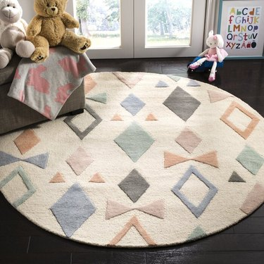 kids' room with toys and multicolored patterned round rug