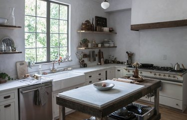 light gray kitchen with plaster walls