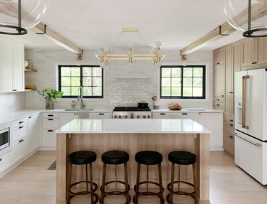 IKEA kitchen with wood and white cabinetry and white countertops