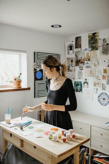 Sofia Shu painting in art studio