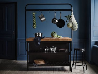 navy blue kitchen with galley trolly in the center