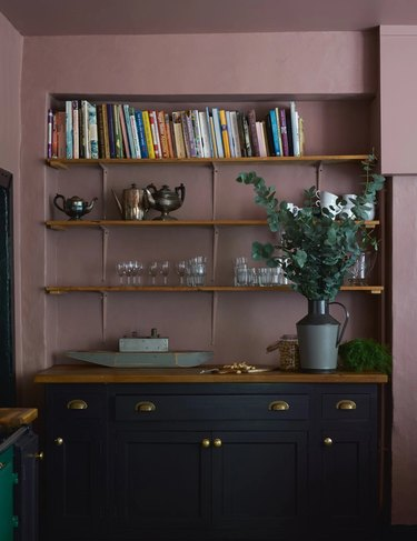 dark lilac kitchen walls with navy blue cabinetry