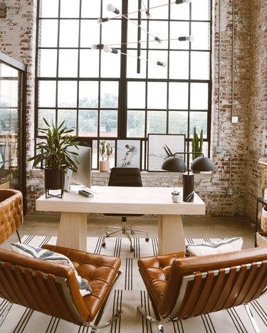 black and brass sputnik chandelier in modern industrial office