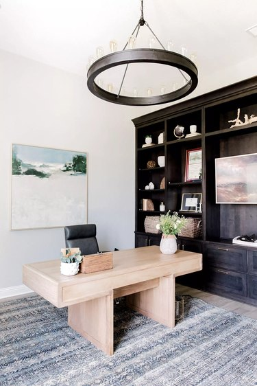 black circular candelabra chandelier in transitional style office