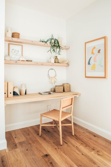 corner home office with wood shelves and leather office chair