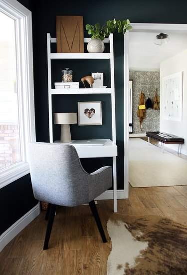 corner home office with desk that includes vertical shelving