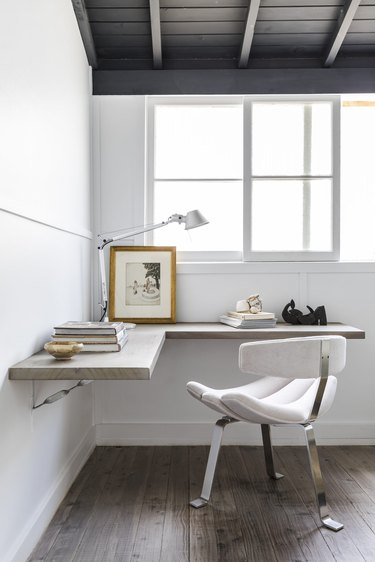 gray corner office with floating L-shaped desk