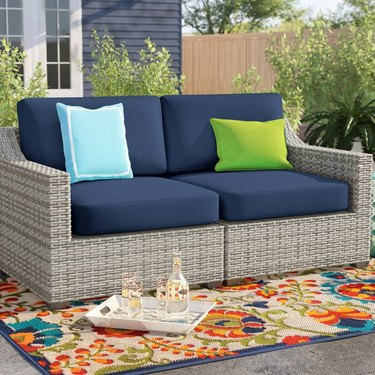 Sol 72 Outdoor Falmouth Wide Outdoor Wicker Loveseat with Cushions