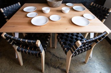 txtur black woven dining chairs at table