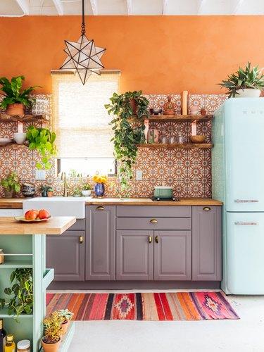 orange kitchen with retro fridge and boho decor