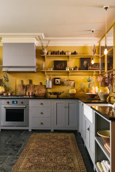 mustard yellow kitchen walls with gray cabinets